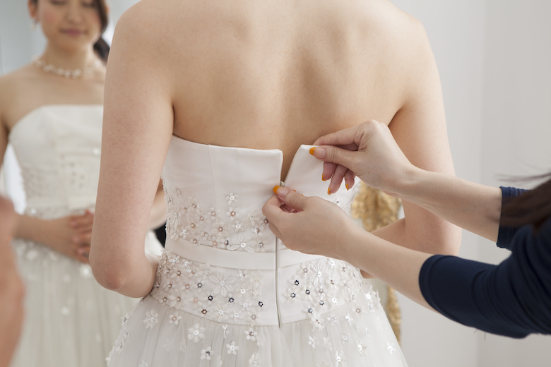 Bride is asked to dress the wedding dress for women