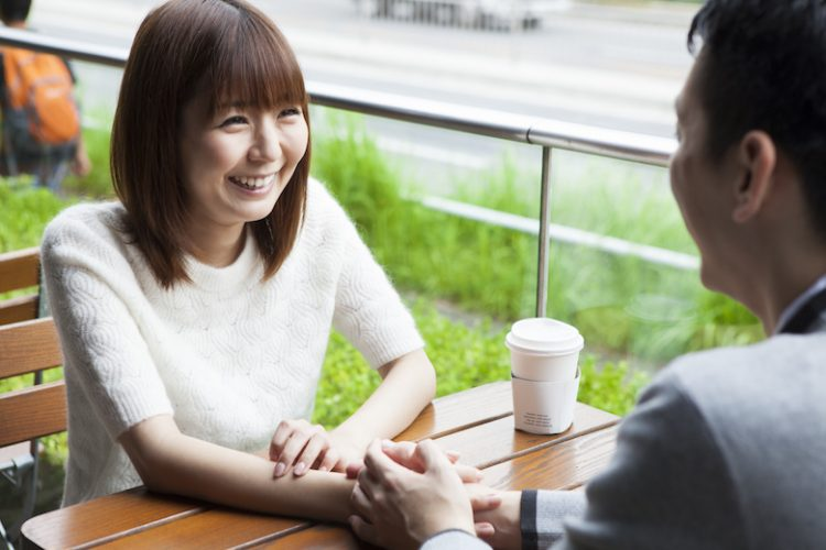 A couple talking on happy cafe terrace