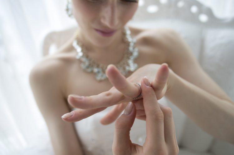 The bride wears a happily wedding ring