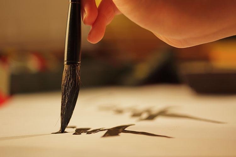 筆で書く人